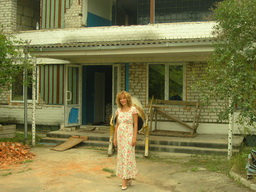Olya standng in front of the former pioneer camp we've been renovating into the mother-baby center